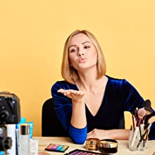 Beauty vlogger recording a video on a yellow backdrop