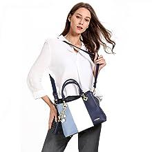 blue handbag model white background