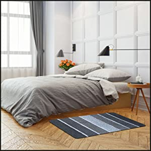 Bedside charcoal rug. perfect ton step on first thing in the morning