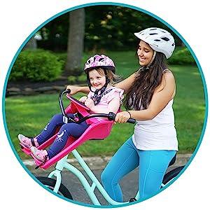 Child sitting in the Kazam iBert Child Bike Seat