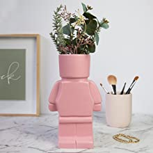 pink block person head pot planter