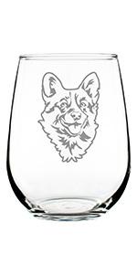 Design of a happy Corgi face engraved onto a stemless wine glass.