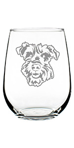 Cute design of a happy Schnauzer face, engraved onto a stemless wine glass