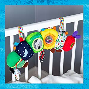 toy hanging in childrens bed
