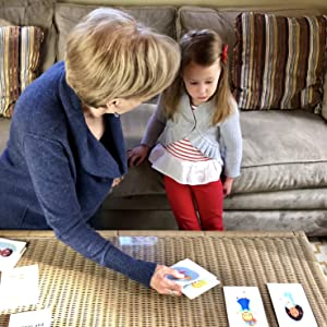 Therapist and kids looking at cards