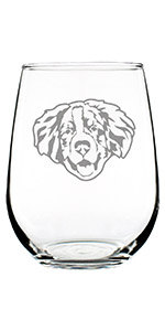Cute design of a happy Bernese Mountain dog face, engraved onto a stemless wine glass