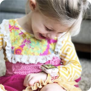 Photo of little kid smiling and laughing while looking down at PlayZoom watch.