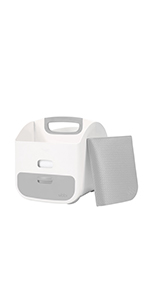 Angled view of the Ubbi gray diaper caddy with gray changing mat leaning against it