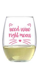 Text says Need wine right meow, with cat ears and whiskers printed in pink around text.