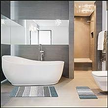 Grey bathroom with a bathtub and a tub mat. whole set fits perfectly in any bathroom