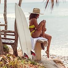 girl surfboard trees hat