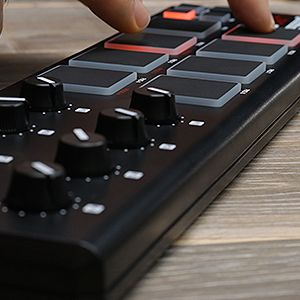 AKAI LPD8  a hand touching on the pads