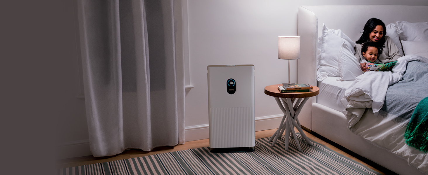woman in bed with child and air purifier