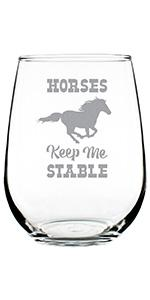 Text says Horses Keep Me Stable, with design of a horse engraved on a stemless wine glass.
