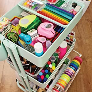 Arts and crafts cart filled with materials like pipe cleaners, ribbon, markers, scissors, and more.