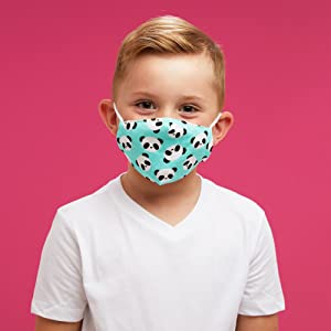 Little boy wearing colorful face mask