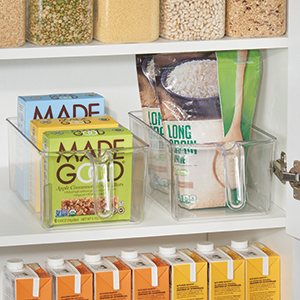 Two Clear Plastic Storage Bins with Handles on Kitchen Pantry Shelf Organizing Dry Food and Snacks