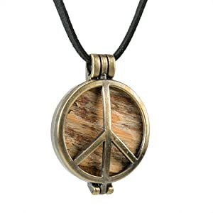 Made from a Piece of the Original Woodstock Stage. Encased Inside a Bronze Peace Pendant