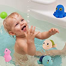 Little boy playing clockwork turtle drifting swimming toys in the bath
