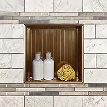 bronze niche installed with tile showing shower organization