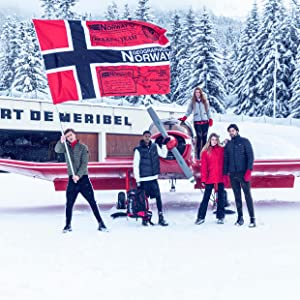 Young people in winter clothing swing a flag