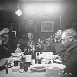 Dinner in the wardroom: Arctowski, Amundsen, Lecointe, Racovitza, and de Gerlache. Fram Museum