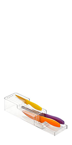 Small clear plastic 2-tier in-drawer knife block on white background containing 3 colorful knives