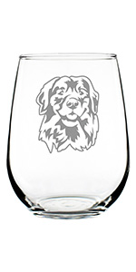 Design of a happy golden retriever face engraved onto a stemless wine glass