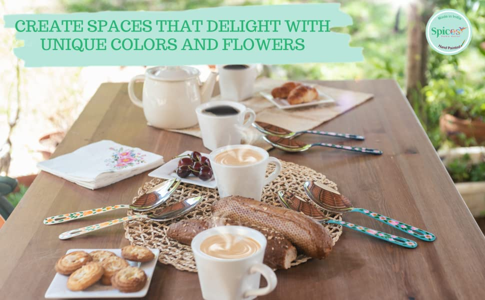 A beautifully decorated and practical, large serving spoon and spork set / salad serving set