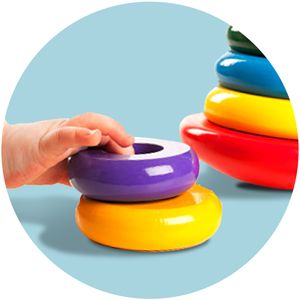 Baby's hand holding toys.