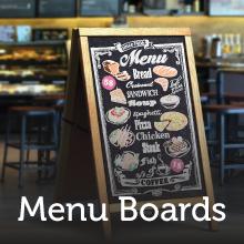 Menu board with chalk marker drawings to make the menu.