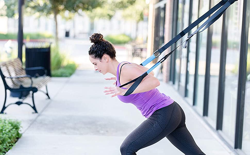 Women using the straps to workout.