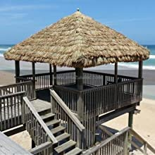 Beautiful thatched outdoor shade structure overlooking the ocean
