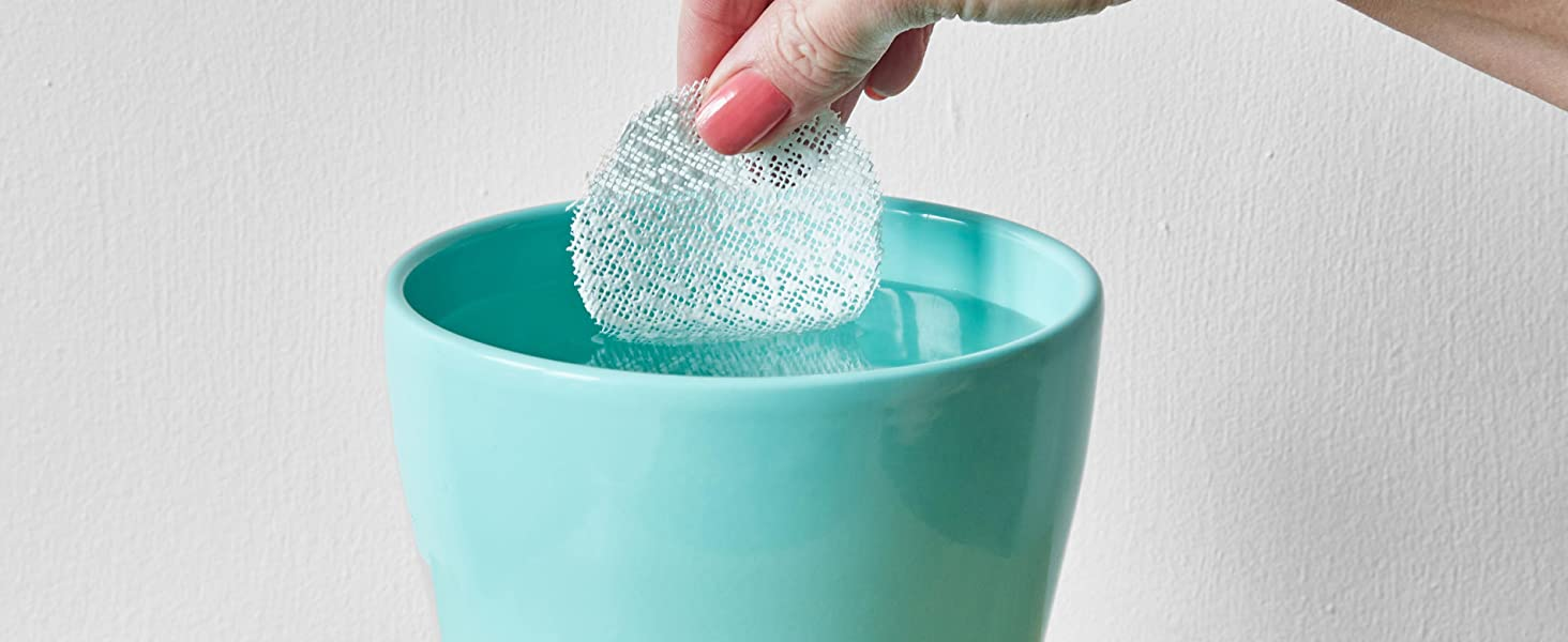 Take disc of WETNFIX from the packet and dip into a container of water.