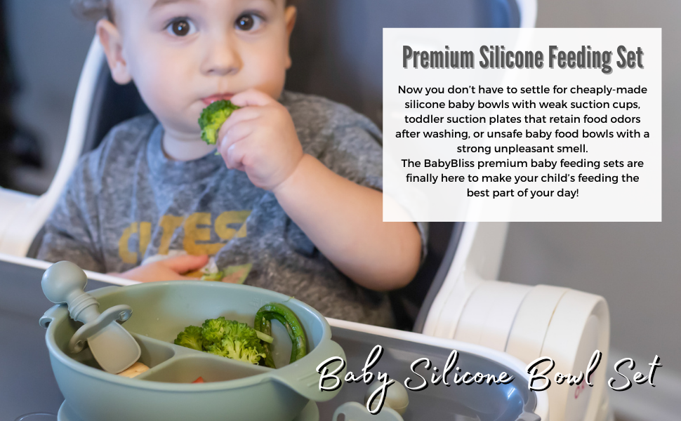 A baby boy eating brocolli using BabyBliss' Silicone Baby Bowl
