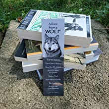 wolf bookmark leaning against stack of books