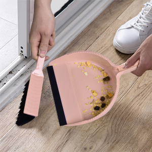 The brush and dustpan set sweeps the groove gap