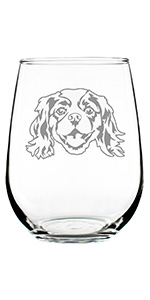 Adorable design of a Cavalier King Charles Spaniel face, engraved onto a stemless wine glass.