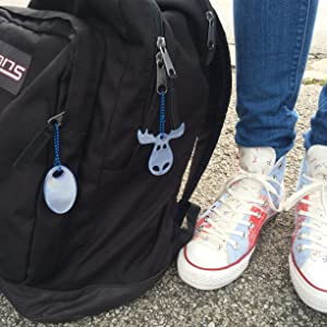 Hang safety reflectors on backpacks