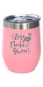 Text says Zero Flocks Given with design of a flamingo, engraved onto a pink wine tumbler