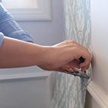 cutting excess of peel and stick wallpaper