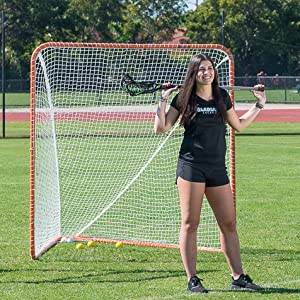Girl standing in front of goal
