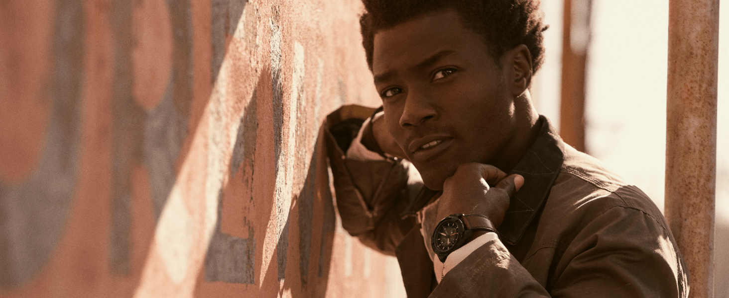 Model wearing black and brown leather fossil watch