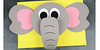 Elephant 3D paper craft project on a yellow background.