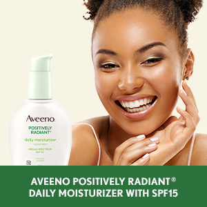 Woman applying Aveeno Positively Radiant Daily Face Moisturizer with SPF 15 sunscreen