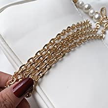 Metal chain, can be cross-body or one shoulder.