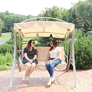 2 people sitting on swing on patio