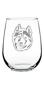 Design of a happy Siberian Husky face engraved onto a stemless wine glass