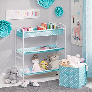 gray nursery corner setting, white storage cart, blue, white polka dot storage shelves and drawers