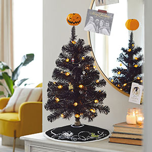 Black Halloween tree with miniature ornaments from NIghtmare Before Christmas